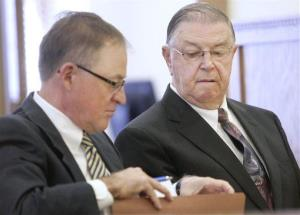 Former Iowa state legislator Henry Rayhons, right, and his attorney Joel Yunek wait for testimony to begin Friday, April 10, 2015, in Rayhons' third-degree sexual abuse trial in Garner, Iowa.