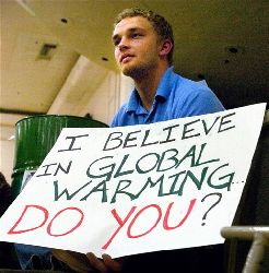 Environmental law student, Michael West, holds a sign in Boulder, Colo., Tuesday, Feb. 12, 2008. The University of Colorado at Boulder is so left-wing, it's endowing a Conservative Chair.