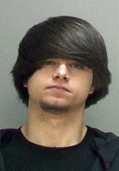This undated photo provided by the Salt Lake County Jail shows Cody Jackson.