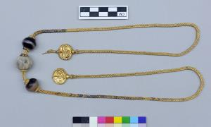 The warrior sure had bling, including this solid-gold necklace.
