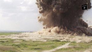 In this image made from a purported ISIS video posted late Saturday, April 11, 2015, purports to show militants destroying the ancient Iraqi Assyrian city of Nimrud in Iraq.