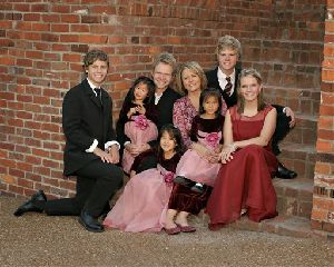 This undated family photo released by the Chapman family show (from left to right): Will Franklin, Maria Sue, Steven Curtis, Shaoey, MaryBeth, Stevey Joy, Caleb, and Emily Chapman.