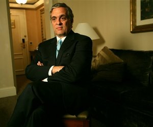 In this  Monday April 30, 2007, file photo, George Tenet, former CIA director, listens during an interview in New York. Tenet made nearly $3 million last year advising private intelligence firms.
