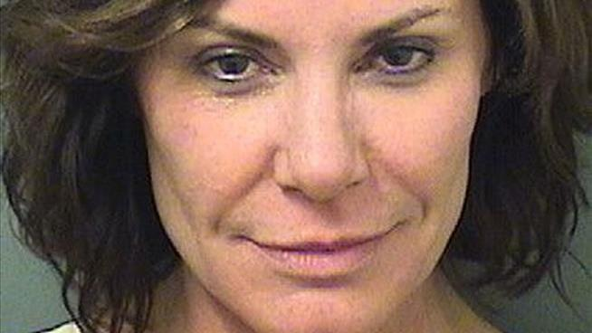 'Real Housewife' charged with trespassing, battery and more