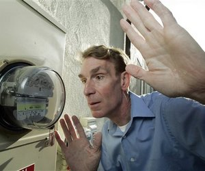 Bill Nye watches his meter run backward as his solar electric panels feed power back into the grid at his California home.