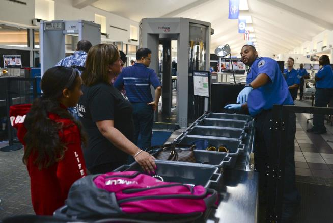 Airport security trays carry more cold germs than toilets, study finds