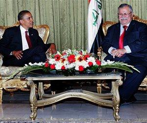 Barack Obama, left, talks to the Iraqi President Jalal Talabani in Baghdad, Iraq, Monday, July 21, 2008.
