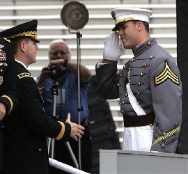 Caleb Campbell, salutes as he receives his diploma at the United States Military Academy at West Point.