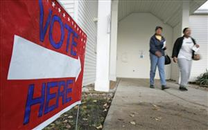 Two women exit a polling place after voting, Tuesday, Nov. 4, 2008, in Pepper Pike, Ohio.