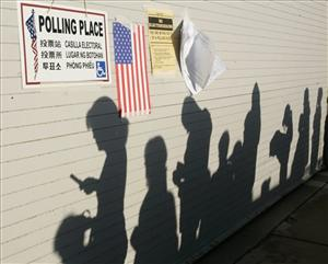 The rising sun casts shadows of voters waiting to vote at a polling place at Venice Beach lifeguard headquarters in Los Angeles' Venice district Tuesday, Nov. 4, 2008.