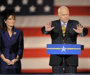 John McCain is joined by Sarah Palin during a rally with supporters on election night in Phoenix, Tuesday, Nov. 4, 2008.