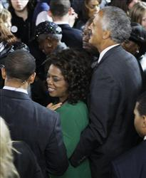 Oprah Winfrey waits with Stedman Graham at the election night party for President-elect Barack Obama at Grant Park in Chicago, Tuesday night, Nov. 4, 2008.