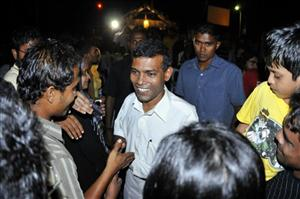 Maldives President-elect Mohamed Nasheed, center, shakes hands with his supporters in a ceremony to celebrate his victory in Male, Maldives, late Wednesday, Oct. 29, 2008. President Maumoon Abdul Gayoom promised to ensure a smooth transition from his three decade rule after Nasheed vanquished him in the Maldives' first democratic election.