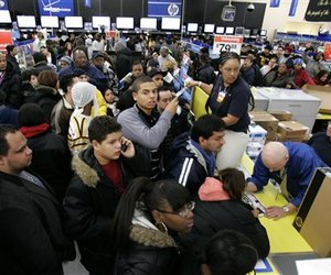 Customers line up to get sale coupons at a Wal-Mart store in Secaucus, N.J., Friday, Nov. 28, 2008.
