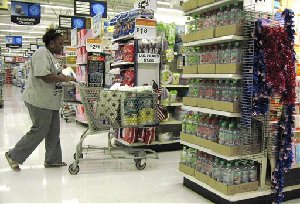 A shopper looks for items to purchase Wednesday, June 13, 2007, at Wal-Mart in San Leandro, Calif.  Consumer prices shot up at the fastest pace in 20 months in May, fueled by a surge in gas prices, although inflation pressures were moderate in most other areas. So far this year,...