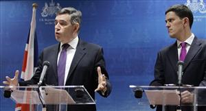 Gordon Brown went for solid purple at a meeting in Brussels. His foreign secretary, David Miliband, opted for a shinier version.