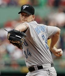 In this Sept. 13, 2008 file photo, onetime Toronto Blue Jays starting pitcher A.J. Burnett winds up.