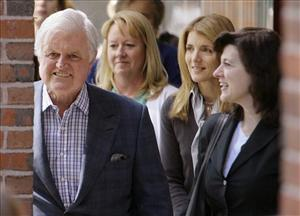 In this May 21, 2008, Sen. Edward M. Kennedy, D-Mass., walks out of at the Massachusetts General Hospital after he was released in Boston, with his wife, Vicki, right, and niece Caroline Kennedy Schlossberg, center right. Kennedy was diagnosed at the hospital with a malignant brain tumor.