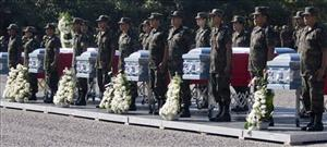 Soldiers stand by the coffins of six members of Mexico's Army during a funeral in Chilpancingo, Mexico, Dec. 22, 2008.
