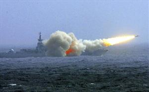 A Chinese destroyer of the South China Sea Fleet fires a missile during training.