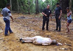 Police officers and residents grimly gather around the body of American missionary Dorothy Stang in Anapu, northern Brazil, after she was shot dead in 2005.