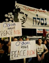Israelis hold signs referring to Barack Obama during a memorial rally marking the 13th anniversary of the assassination of Yitzhak Rabin in Tel Aviv, Israel, late last year.