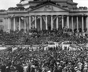 In this March 4, 1905 file photo, President-elect Theodore Roosevelt takes the oath of office on the east portico of the US Capitol during his inauguration ceremony in Washington.