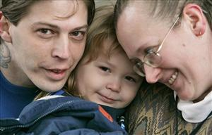 Heath Campbell, left, with his wife Deborah and son Adolf Hitler, 3, pose in Easton, Pa., last month.