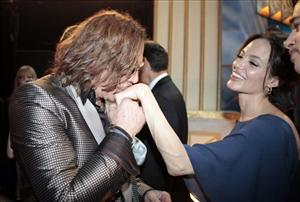 Actor Mickey Rourke, left, kisses Angelina Jolie's hand during the 15th Annual Screen Actors Guild Awards on Sunday, Jan. 25, 2009, in Los Angeles.