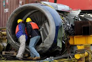 The engine of US Airlines Flight 1549 is examined after it was retrieved from the Hudson River Friday, Jan. 23, 2009. Investigators hope it will help determine the cause of the crash.