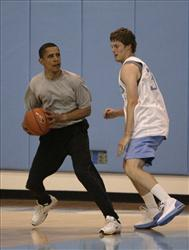 In this April 29, 2008 file photo, then-Democratic presidential hopeful Sen. Barack Obama plays basketball in Chapel Hill, N.C.
