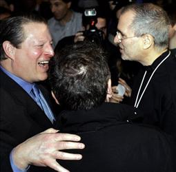 Former Vice President Al Gore, left, speaks with Apple CEO Steve Jobs, right. Gore is on the Apple board, which has been criticized for not sharing more about Jobs' health.