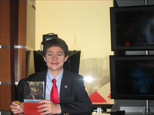 Jonathan Krohn poses with his book at 2009's CPAC conference.