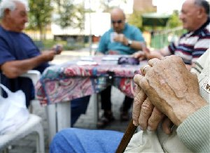 Elderly men play cards at an old people's recreation center in Milan, northern Italy, April 27, 2007. Italian life expectancy is 78.3 years for men and 84 for women. But more significantly, Italy holds the world record for the highest percentage of what experts call the old old.  (AP...