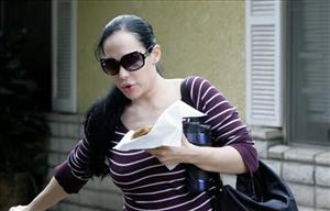 In this March 11, 2009 file photo Nadya Suleman, the mother of octuplets leaves her home in Whittier, Calif.