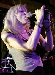 Singer Courtney Love performs a private concert in the Hiro Ballroom at The Maritime Hotel Thursday, July 12, 2007 in New York.