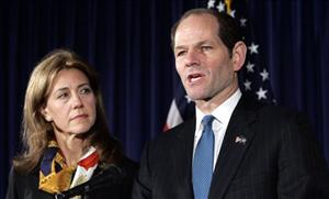 Then-New York Gov. Elliot Spitzer announces his resignation as his wife Silda looks on Wednesday, March 12, 2008, in his offices in New York City.