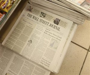 Tuesday editions of Barron's and The Wall Street Journal are on a New York newsstand, Tuesday, July 31, 2007.
