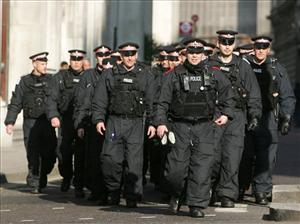 Police officers outside the Bank of England at the G20 protest.