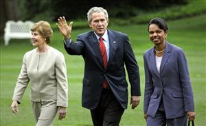 Former president George W. Bush with his wife Laura and Secretary of State Condoleezza Rice.