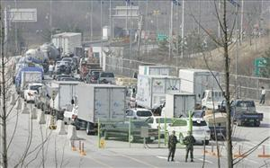 South Korean vehicles heading to the North Korean city of Kaesong wait to pass the gate at the customs, immigration and quarantine office near a border village in South Korea on April 6, 2009.