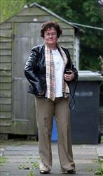 Susan Boyle, whose performance on television show Britain's Got Talent sparked global interest, outside her home in Blackburn, Scotland, revealing a new look after undergoing a makeover April 24, 2009.