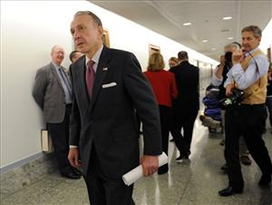 Former Republican Sen. Arlen Specter, D-Pa., walks in the halls of the Dirksen Senate office building Thursday, April 30, 2009.