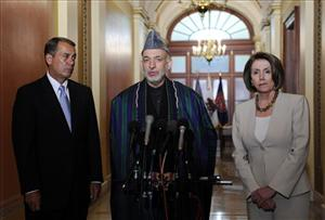 Afghan President Hamid Karzai, flanked by House Minority Leader John Boehner and Speaker Nancy Pelosi, speaks to reporters on Capitol Hill in Washington, Tuesday, May 5, 2009.