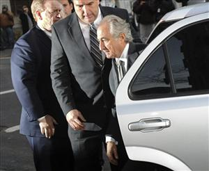 In this March 12, 2009 file photo, Bernard Madoff arrives at Manhattan federal court in New York.