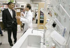 Democratic presidential hopeful U.S. Sen. Barack Obama, D-Ill., talks with Dr. Mark Anderson while touring a cardiology research lab before speaking about his health care plan on Tuesday, May 29, 2007.
