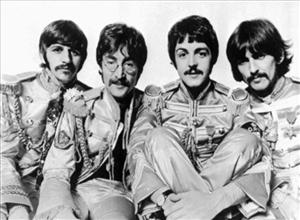 The rock group, The Beatles, are shown in 1967 in their Sgt. Pepper outfits. That album's Lucy in the Sky With Diamonds was inspired by a picture drawn by Julian Lennon.