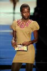 A model walks the runway at the This Day/Arise Magazine: African Fashion Collective Fall 2009 fashion show during Mercedes-Benz Fashion Week on February 13, 2009 in New York City.