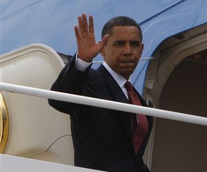 President Barack Obama waves as he prepares to board Air Force One at Andrews Air Force in Maryland, Monday, June 15, 2009.