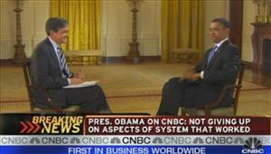 This image made from video released by CNBC, shows President Barack Obama smacking a fly dead during an interview with CNBC correspondent John Harwood.
